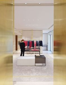 Oma maison ullens flagship store interior paris golden panels line the doorway between two display rooms on one side of wall garments are show also by london design journal furniture ideas rh pinterest