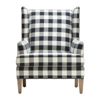 Fireside chic. A classic wing-back chair with a generous ...