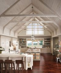 Raised door panels and open shelving in light colors, plus ...