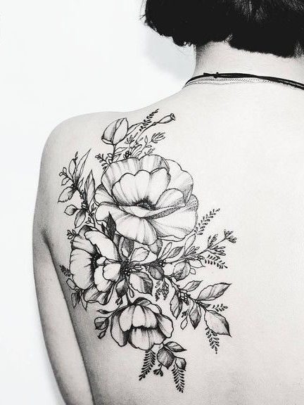 intricate flower tattoo. click