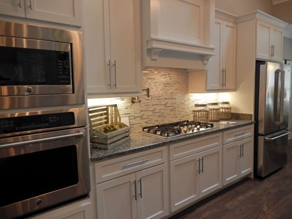 white kitchen with grey granite White Kitchen Cabinets. Gray Granite Countertops. New
