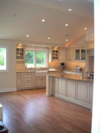 vaulted kitchen ceiling with transom window above sink ...