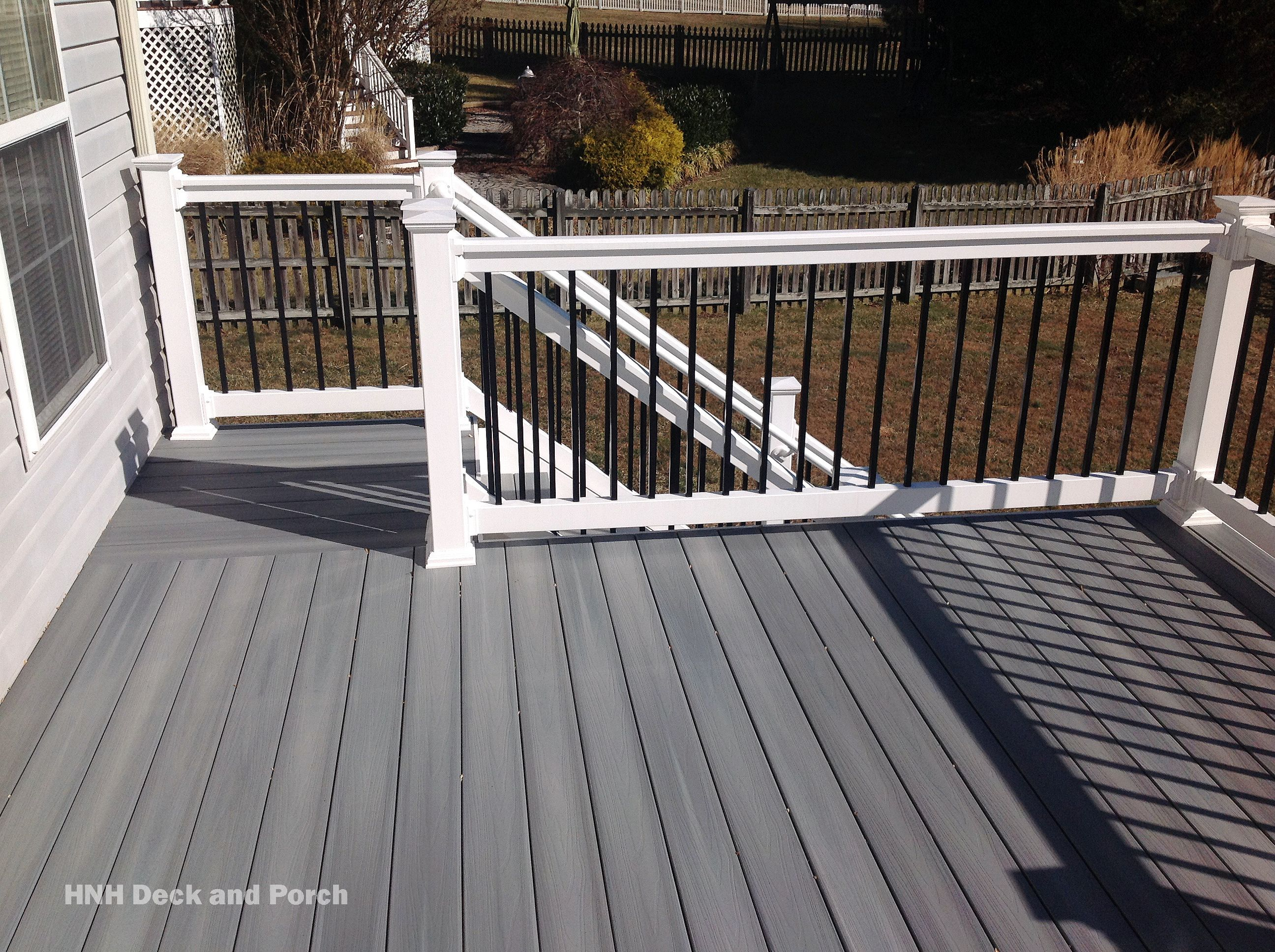 Composite Deck Using Fiberondecking Castle Grey Decking With White Pvc Railing And Black Square Aluminum