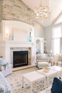 Light and airy living room with fireplace, built