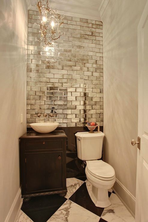 Powder room mirrored subway tiles they look cool in this bathroom also dk and ab rh pinterest