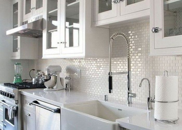 White kitchen cabinets glass doors dark wood floors and mini subway tile backsplash also beautiful with farmhouse sink some