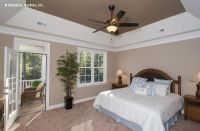 A tray ceiling frames this master bedroom! The Lennon ...