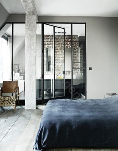 Industrial meets design classics  parisian loft love the steel and glass wall doors that open up to master bath also bed chambre pinterest exposed brick bedrooms rh