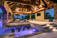 Fantastic multi-use pool area with swim up bar, built-in ...