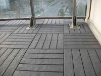 Charcoal-Grey floor decking tiles on balcony floor. We ...