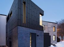 Dark zinc-clad extension added to historic dwelling in ...