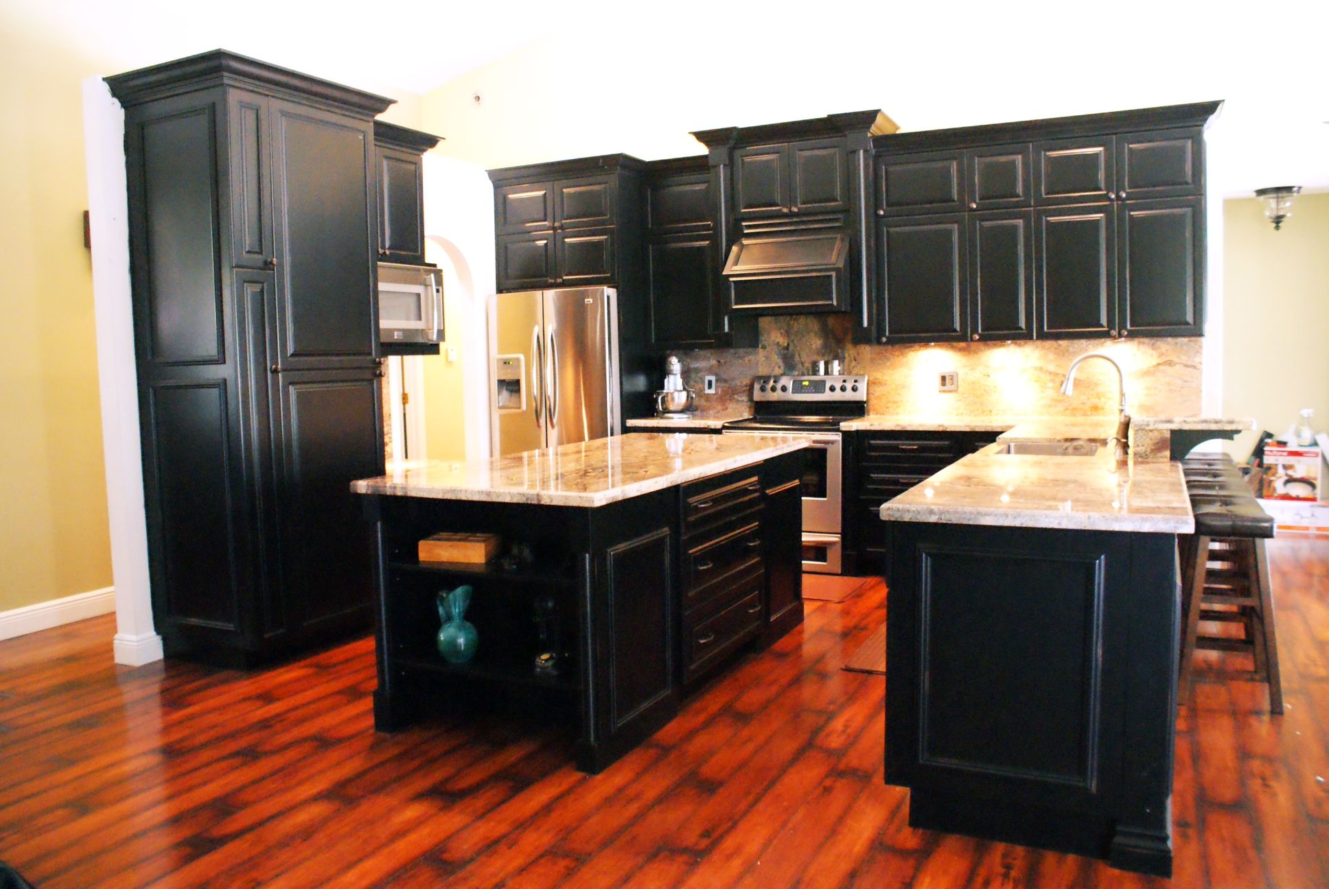distressed black kitchen cabinets rug for under table our custom built kitchens