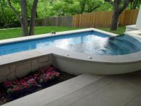 Perfect lap pool set close to the home with sloped lawn ...