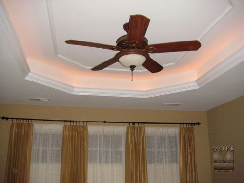 tray ceiling with lighting behind the crown molding
