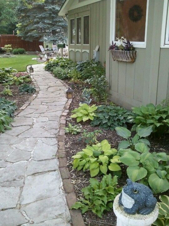 Side Yard Flagstone Path Set In Concrete With Hostas On Either