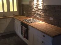 Slate wall tiles with an Ivory kitchen and oak worktop ...