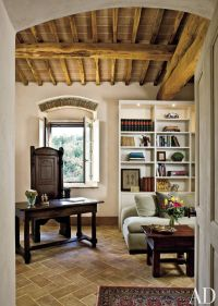 Rustic Office/Library by Spectrum Interior Design and