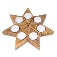 The set is made up of seven diamond-shaped tealight ...