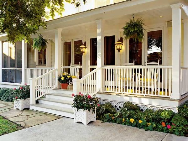 front porch ideas on a budget white rockers against white house with hanging and potted