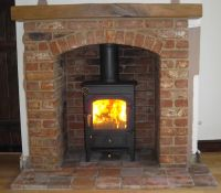 Clearview Pioneer wood burning stove with brick arch and ...