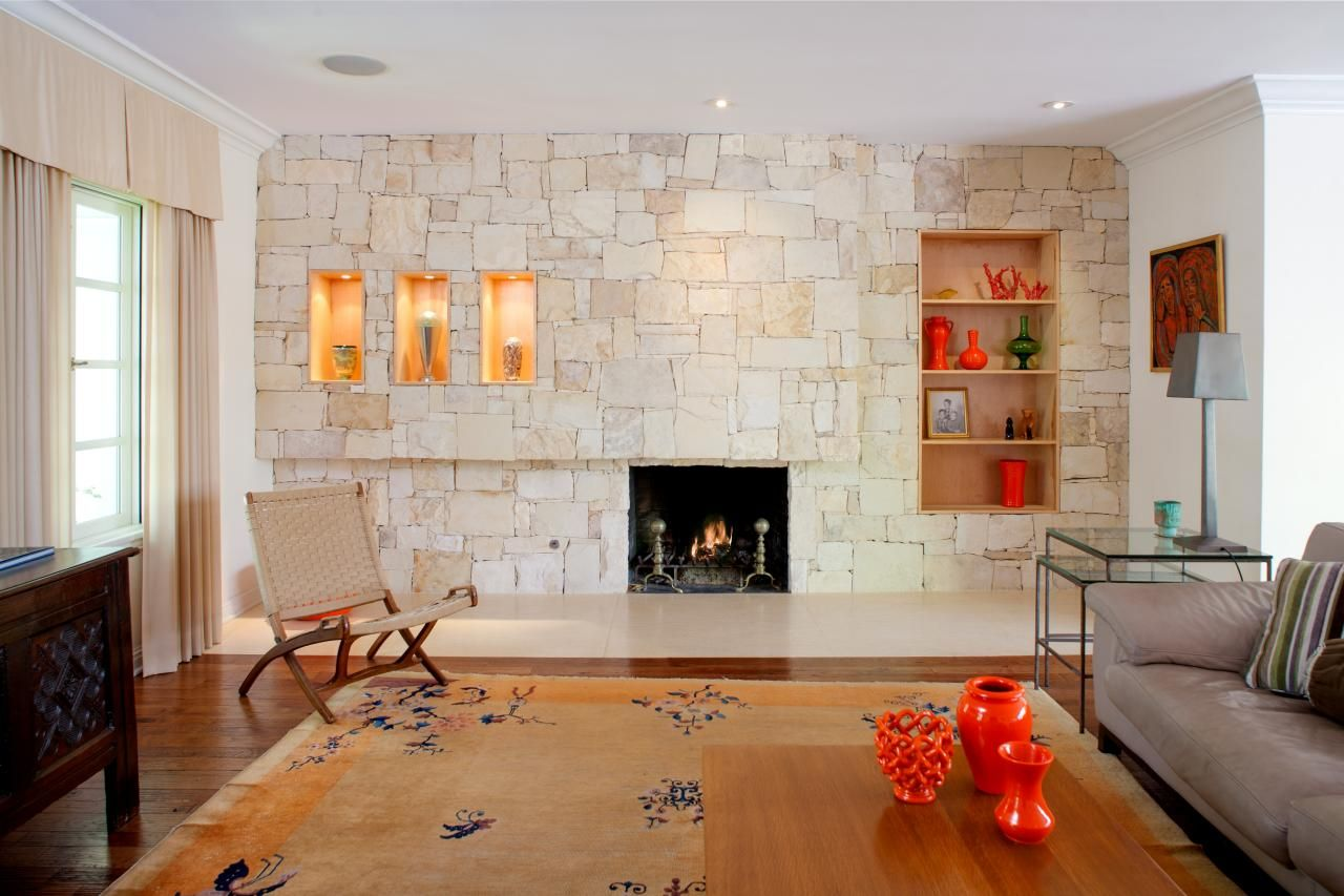 The fireplace wall features a drystacked stone facade
