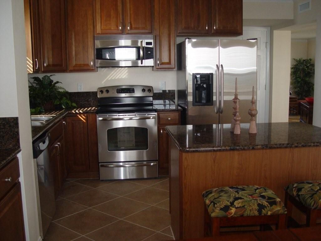 kitchen floor cabinets what color for a small kitchens with oak and tile floors area