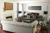 Gray living room with a two sofa layout. Two sofas facing ...