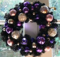 Black Christmas wreath with puple & gold ornaments. I love ...