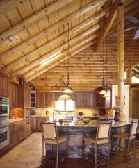 cathedral ceiling in a log home | log home kitchen with ...