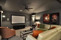 I like the gray walls in this media room with the pop of ...