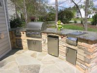 backyard patio with kitchen ideas | This custom outdoor ...