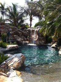 Lagoon backyard pool with beach entry, man
