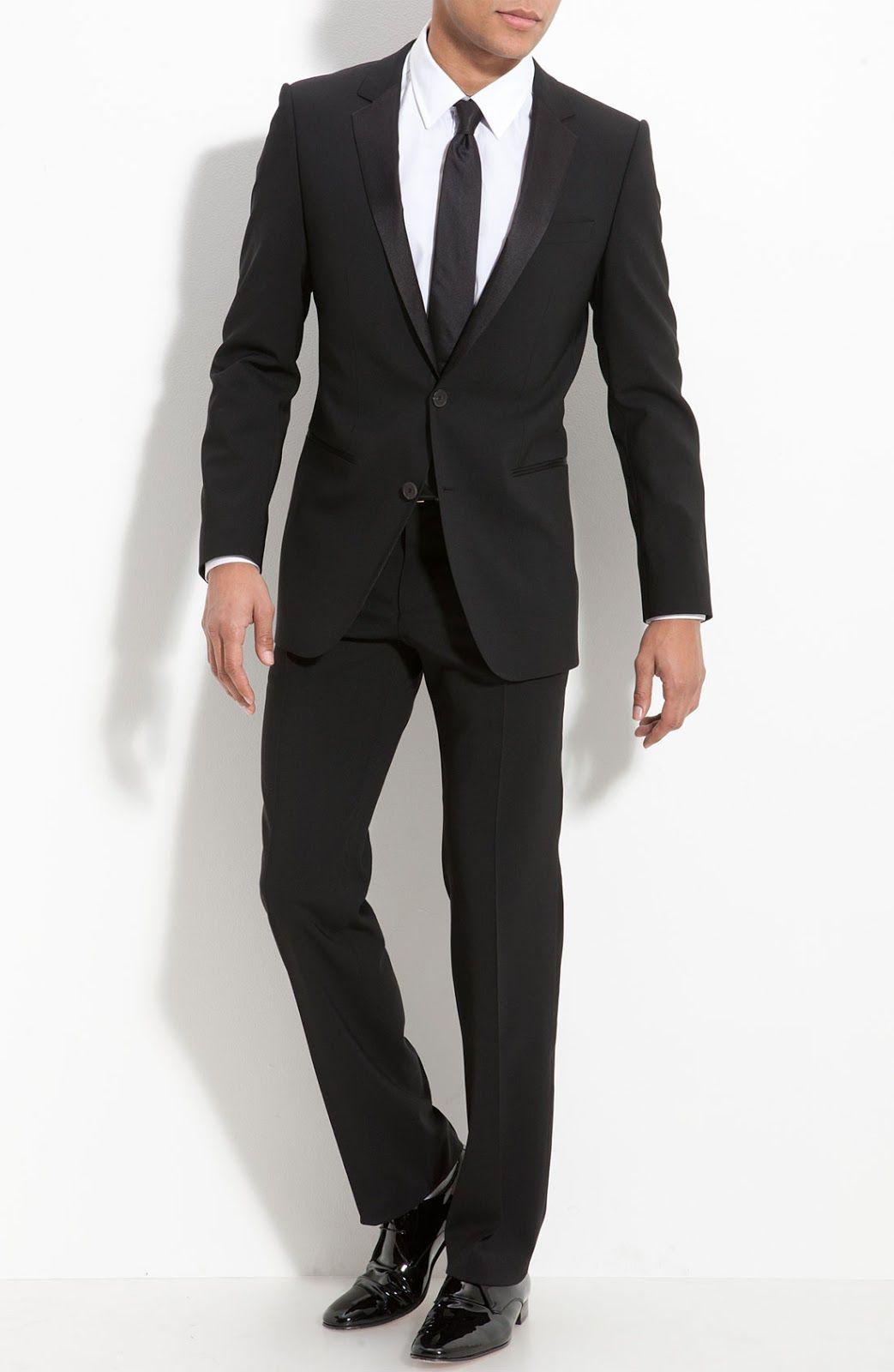 Simple black tux, slender black tie, no vest.