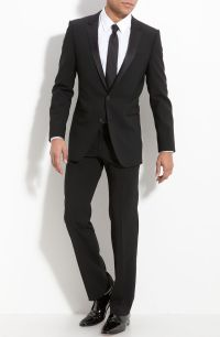 Simple black tux, slender black tie, no vest.