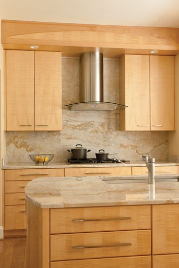Vallon paired Tigers Eye maple cabinets with marblelike granite countertops  Kitchen and