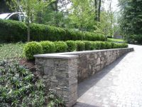 Leydon Landscaping Inc: Paver driveway with retaining wall