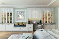 Custom Shaker style bedroom wall unit features a built