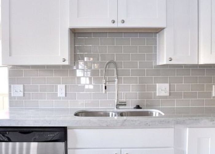 Glass smoke gray subway tile white shaker cabinets also and