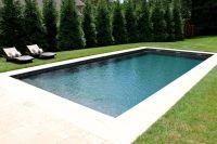 Simple rectangular fiberglass pool with sheer descents ...