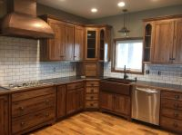 White subway tile, dark grout with stained hickory ...