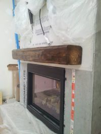 Installing a barn beam mantel BEFORE the stone is the best ...