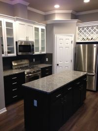 White upper cabinets with espresso lower cabinets. Love ...