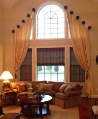 Love this! A two story living room requires a dramatic ...