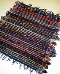 Not sure what to do with all those old ties....make a rug ...