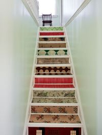 Narrow enclosed staircase. With a small staircase, you don ...