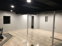 Exposed black dryfall basement ceiling, finishing basement