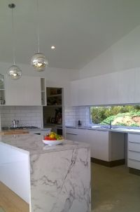 White subway tile with black grout + Carrara marble ...