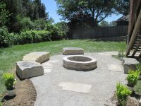 Large limestone seating around limestone fire pit with ...