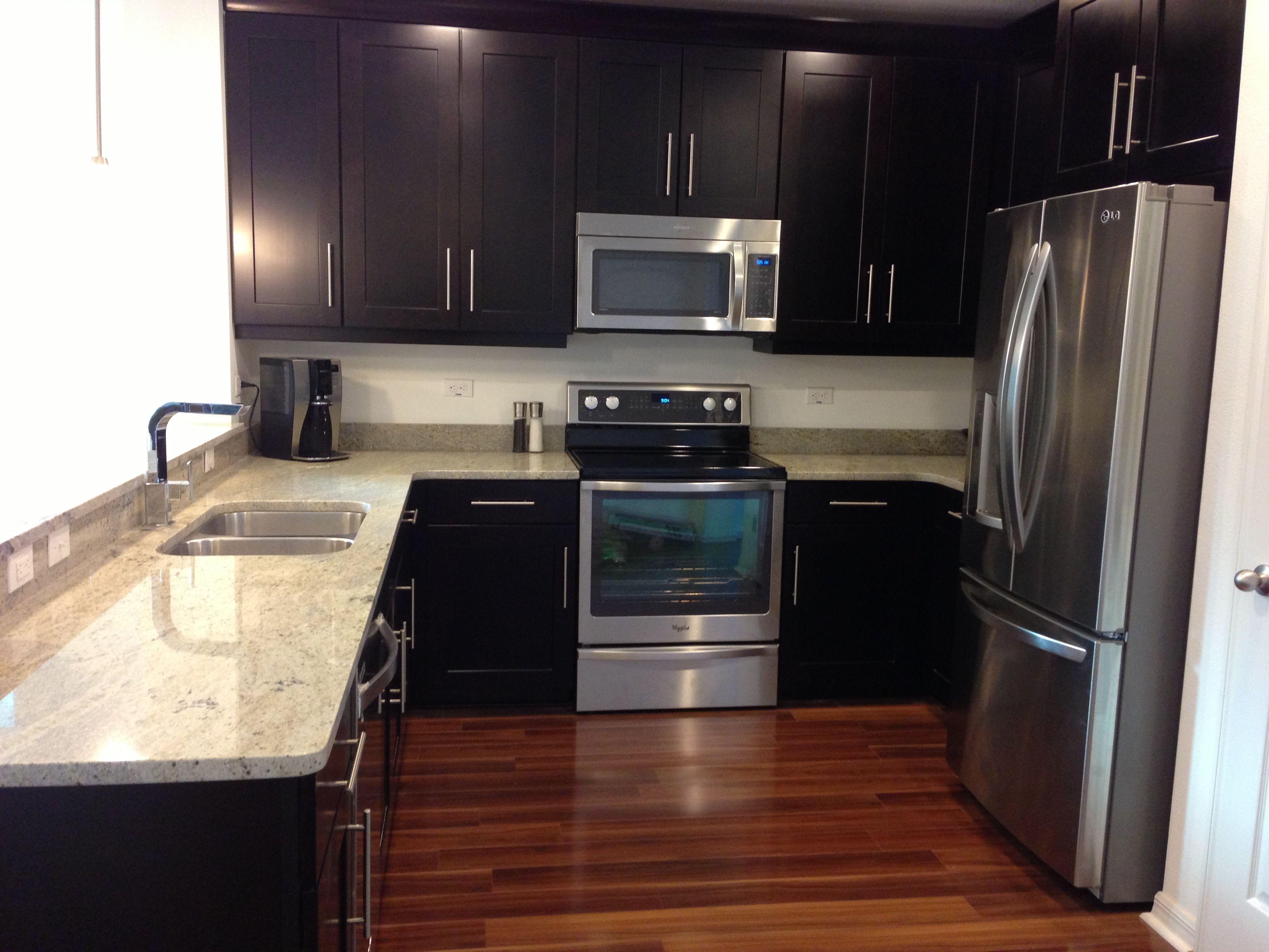 espresso and white kitchen cabinets with crown molding kashmere granite visconti walnut
