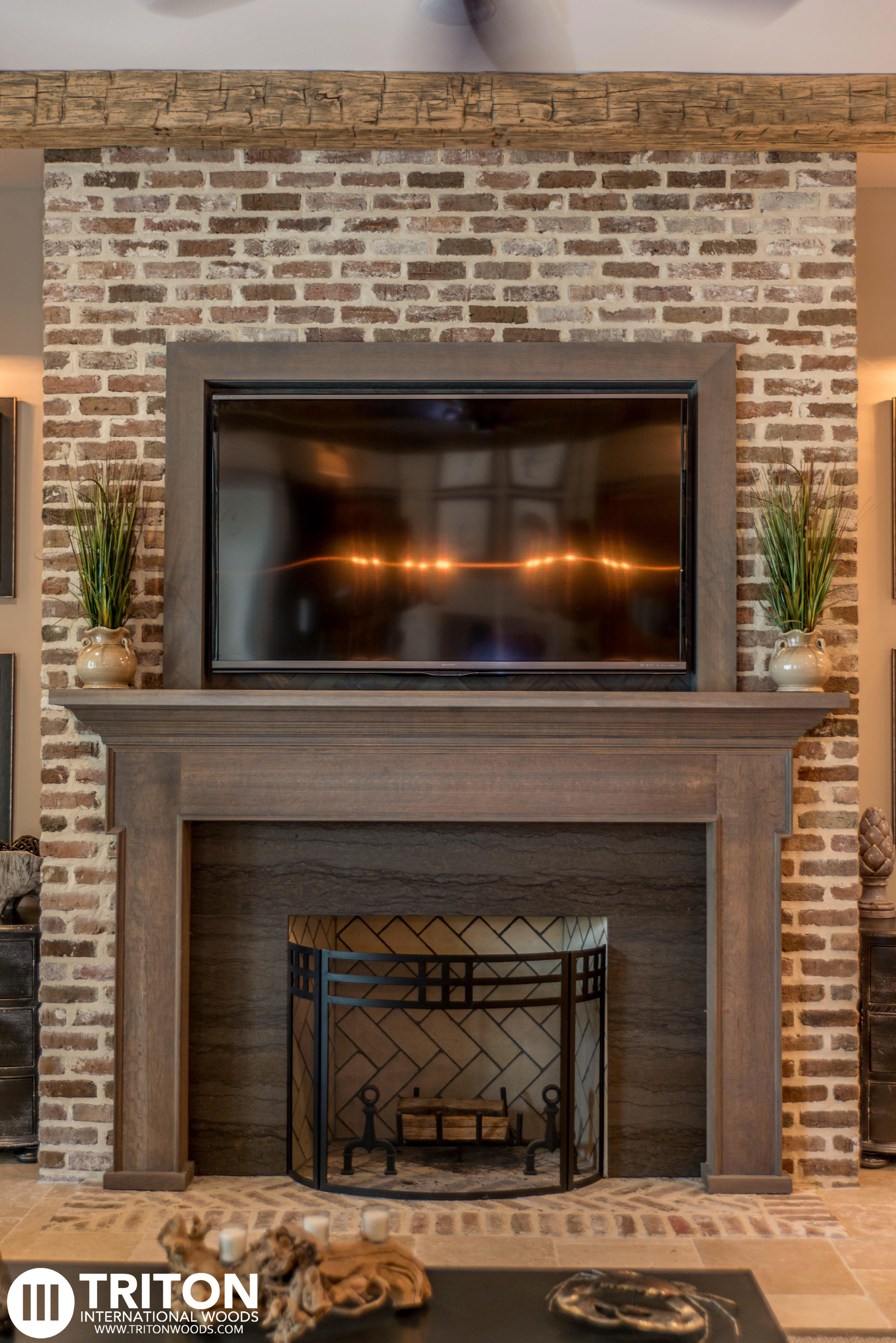 Reclaimed Brick Fireplace Also provided Reclaimed beams mantel and TV enclosure  Reclaimed